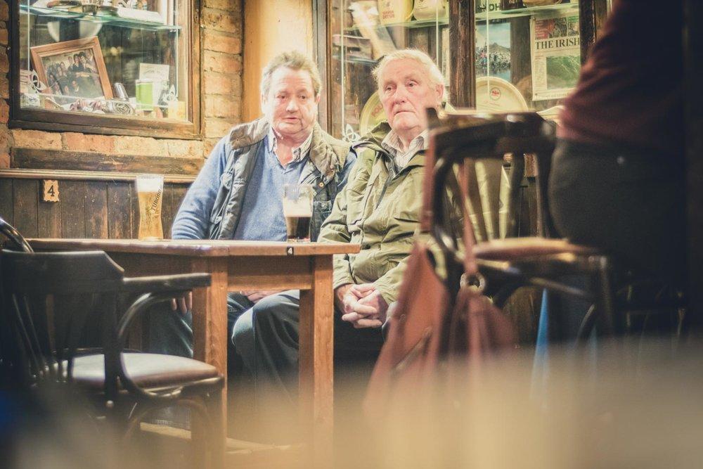 two men chatting in an old irish pub