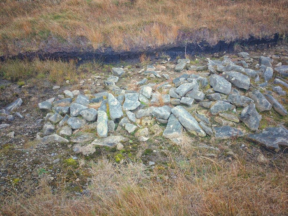 looking down at 6000 year old wall