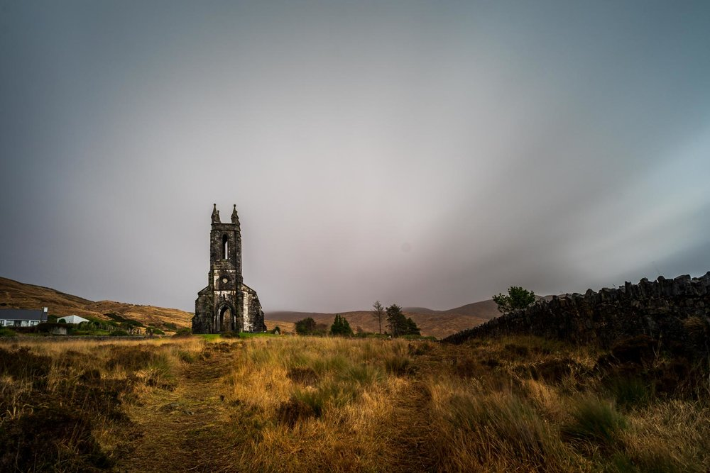 old irish church with dark clouds