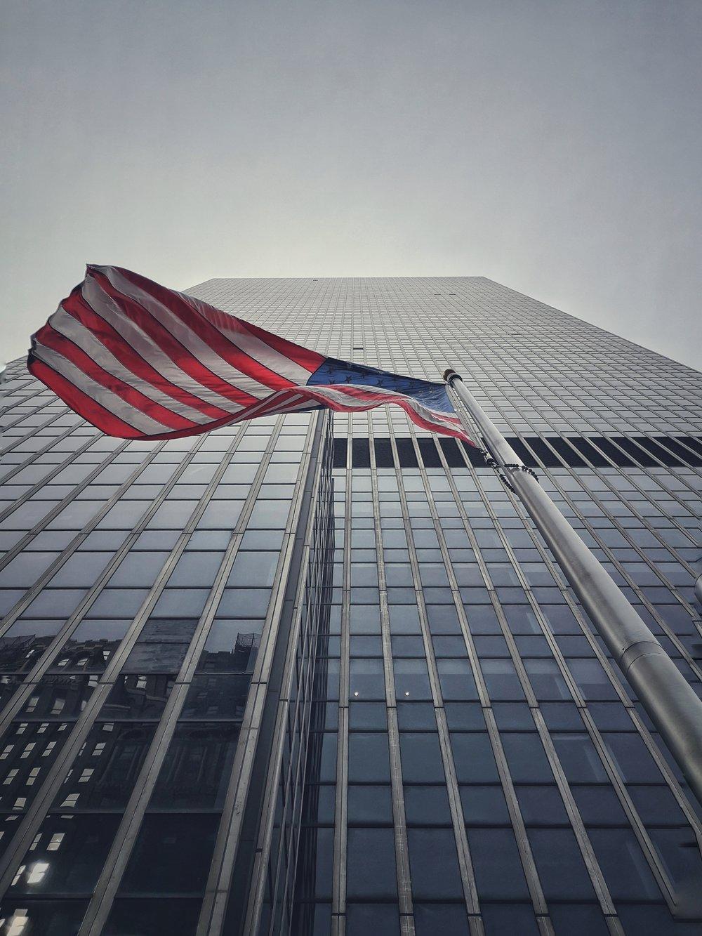 USA flag and tall new york building.jpeg