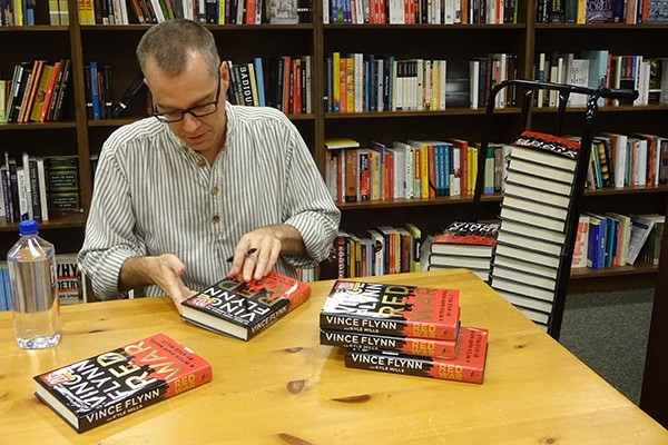 Getting ready for the first event at Barnes & Noble, Roseville. We set up an assembly line. Staff wheeled in books on dollies and I signed. Photo: @VinceFlynnFans