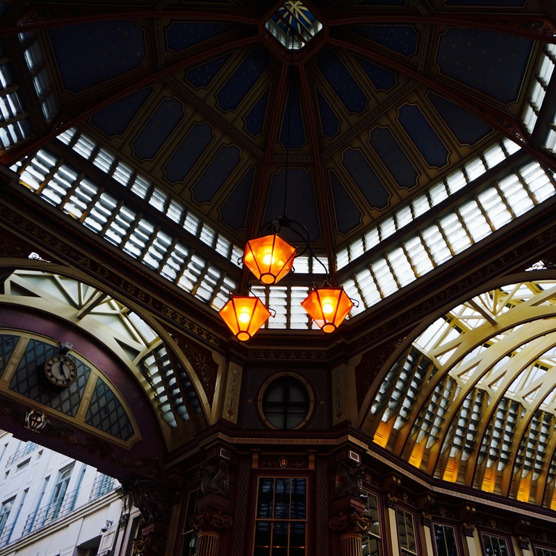 Leadenhall Market   The market dates from the 14th century and stands on what was the centre of Roman London. Originally a meat, game and poultry market it is now home to cheesemongers, butchers, florists, and other commercial retail vendors and restaurants.  The Grade II listed market was designed in 1881 by Jones and has a spectacularly ornate roof and cobbled floors. It underwent a dramatic redecoration between 1990 and 1991 which transformed its appearance, enhancing its architectural character and detail.