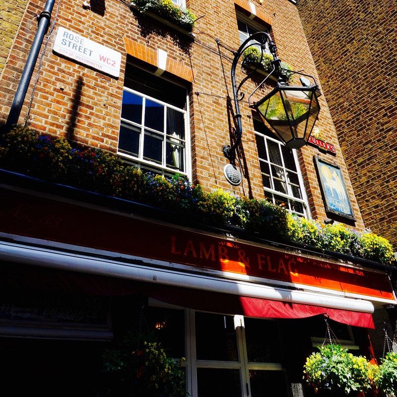 The Lamb & Flag, WC2E  The first mention of a pub on the site of The Lamb & Flag is in 1772, then known as The Coopers Arms it changed to The Lamb & Flag in 1833.The building's brickwork is from around 1958 and conceals what may be an early 18th century frame of a house, replacing the original one built in 1638.