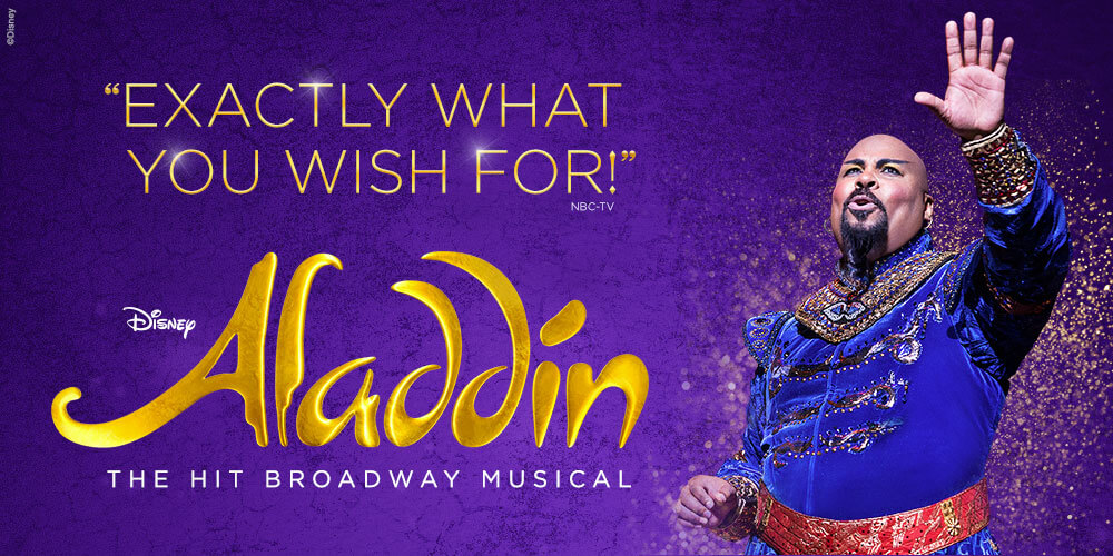 """Image description: royal purple background, at left gold and white text reads : quote """"Exactly what you wish for!"""" - NBC-TV endquote. Disney """"Aladdin"""" The Hit Broadway Musical. At right, The Genie (Anthony Murphy) sings with left arm raised."""