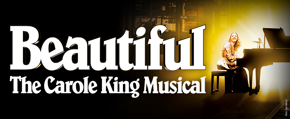"""Image description: Text at left and center reads: """"Beautiful"""" The Carole King Musical. At far right Carole King (Chilina Kennedy) sits facing outward at a black grand piano with a glowing yellow light shining from behind it."""