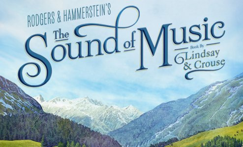 """Image description: bottom half covered in snowcapped mountain range with foreground of grassy hill with evergreen trees. top half blue sky with scattered clouds. Text over sky in blue script reads """"Rodgers & Hammerstein's """"The Sound of Music"""" Book by Lindsay & Crouse""""."""