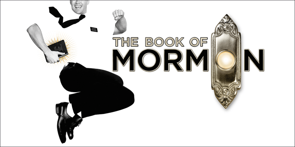 """Image Description: bright white infinity background, at left is black and white photo cutout of a man dressed in white shirt with a name tag, black tie, black slacks, jumping in air with a grin and tucked under right arm is The Book of Mormon. Across center and right, silver and black text reads """"The Book of Mormon"""", where second 'O' on Mormon is replaced with a silver doorknob and plate."""