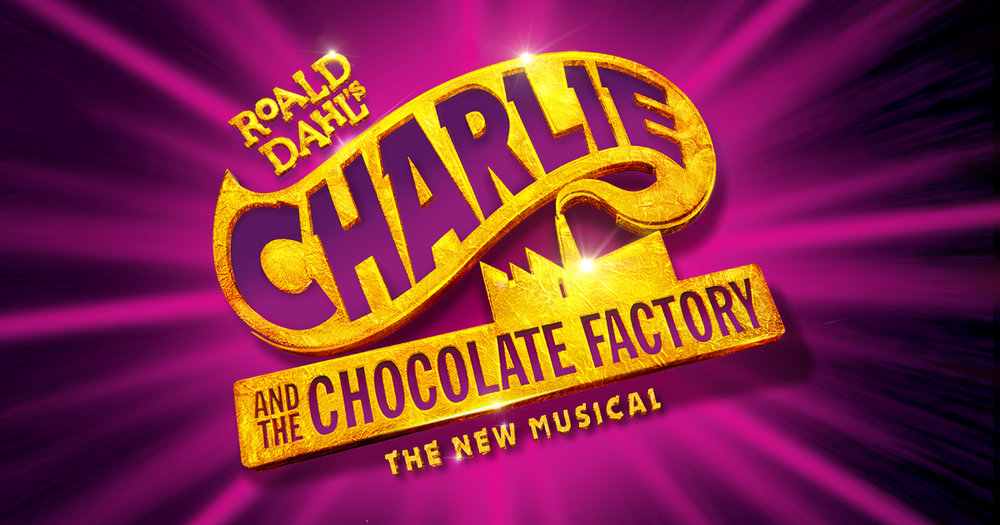 """Image Description: Charlie and the Chocolate Factory production graphic. Bright purple light burst, over center sparkling gold text reads """"Roald Dahl's Charlie and the Chocolate Factory: The New Musical"""". Placed above lower text is a factory silhouette and encompassing upper text is a smoke stack plume."""