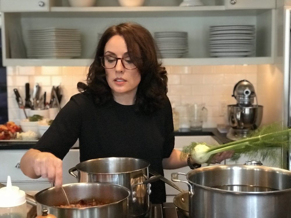 Image of: Tracey Medeiros  Here I am creating a rich Smokey Lamb Bolognese in their beautiful commercial kitchen.  The recipe can be found on page 239 in   The Vermont Non-GMO Cookbook  .