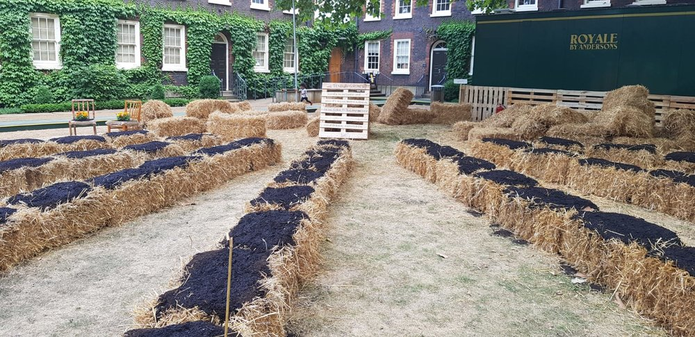 Garden-Share on straw bales at the Beautiful Allotment. (Picture owned by Bourne and Hollingsworth Presents)