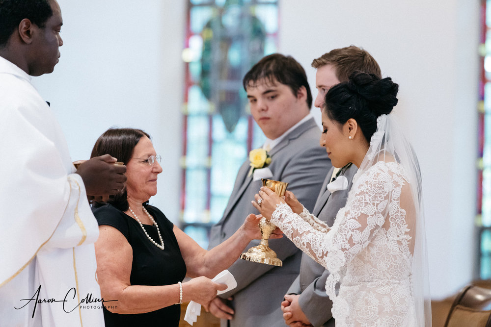 Drinking from the chalice at a catholic wedding