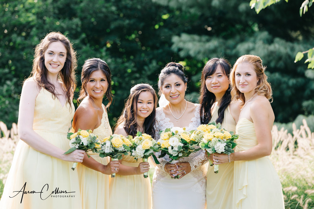 Bridesmaids and bride holding bouquets at Green Hill Park in Worcester MA
