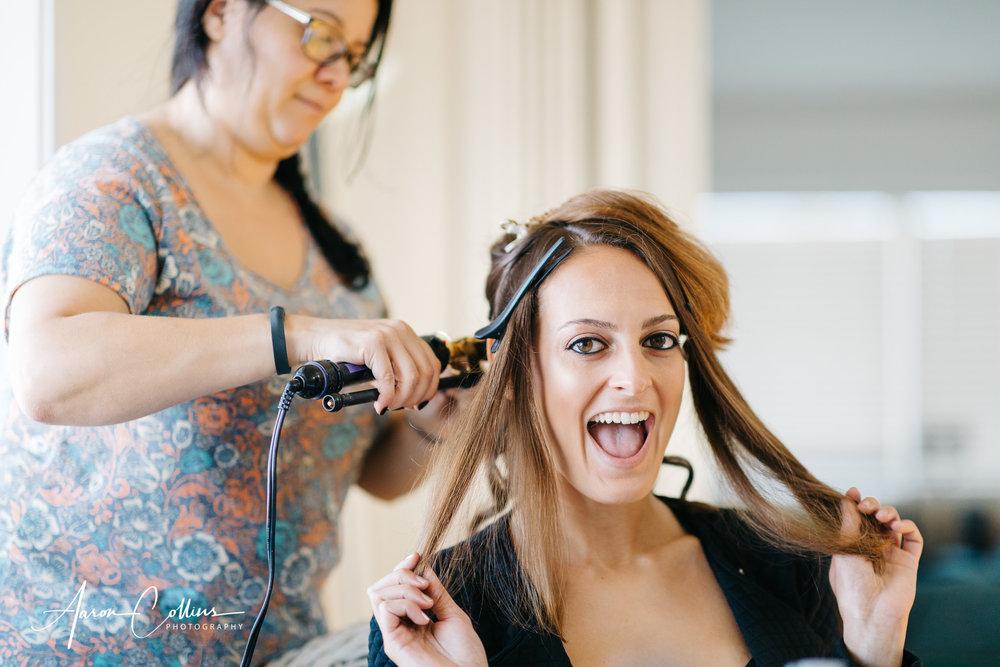 A jubilant bridesmaid getting her hair styled by Danielle from  Eala Bhàn Studio