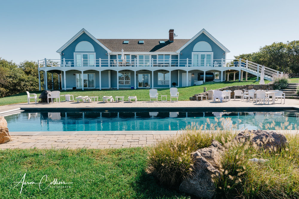 View of the backyard, deck, and pool of the Villakula house on Block Island on their wedding day.