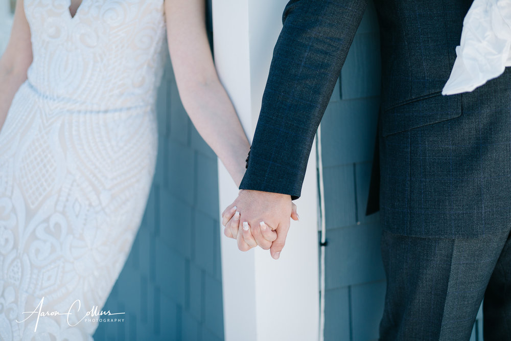 Bride and groom holding hands after they exchange gifts