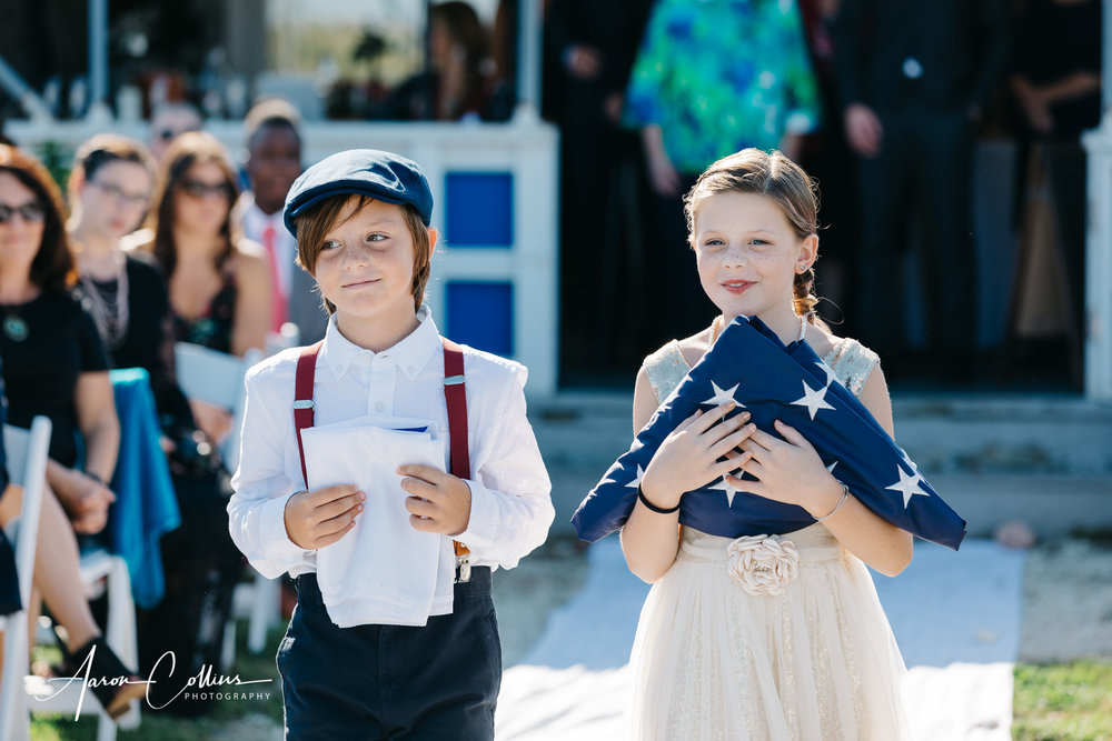 Kids carrying the flag for the naval flag raising ceremony before the wedding