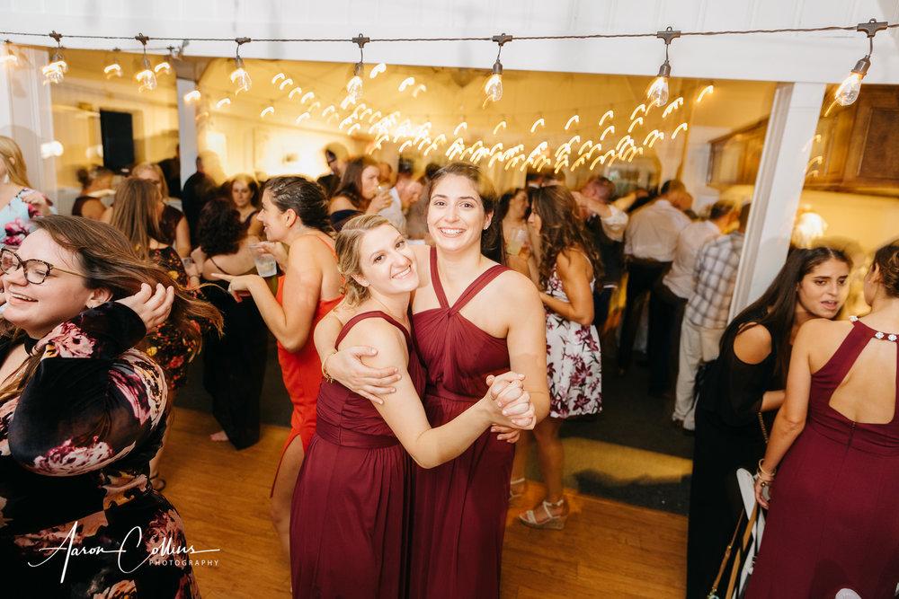 Bridesmaids dancing and having fun at BIMI wedding reception.