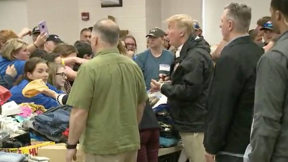 ( WJHL ) President Trump signs Bibles for Alabama tornado survivors