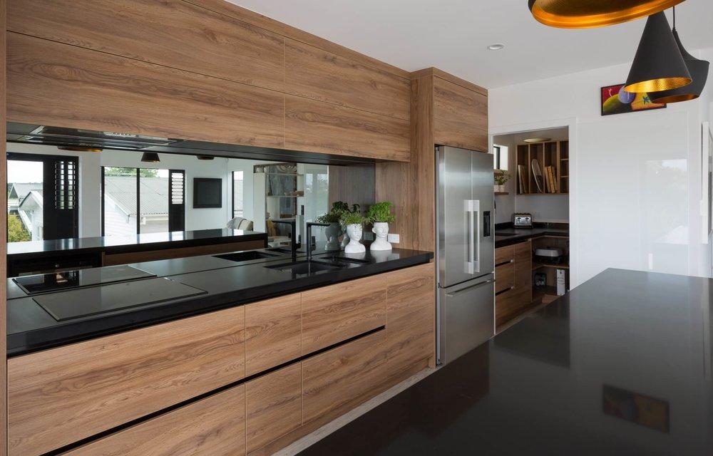 Dark Grey Mirror Splashback On Rimu Cabinetry Kitchen