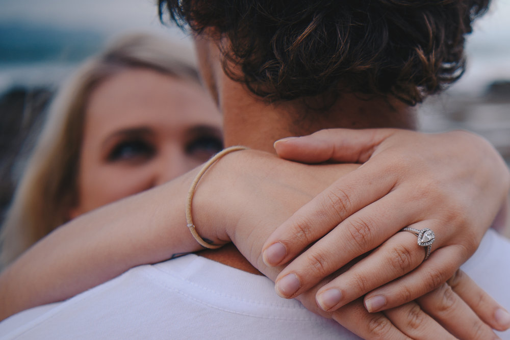 close up of the ring during an engagment session by panoramic photography