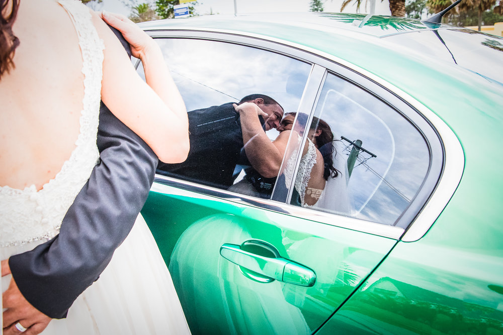 fun wedding photography of reflection in car window