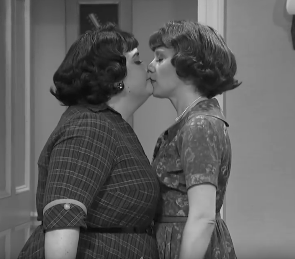 Two women kissing straightly, much like April May.
