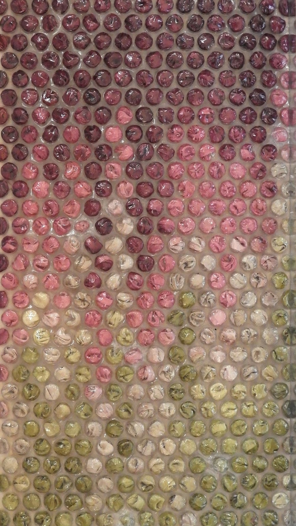 Bubble wrap textile art which features as part of Gail Hawes exhibition ROUND. All artworks featured bubble wrap filled with a variety of textiles including wool, hand made felt, silk fabric. This artwork features multi coloured silk filled into bubbles to create an effect of bougainvillea hanging in a garden
