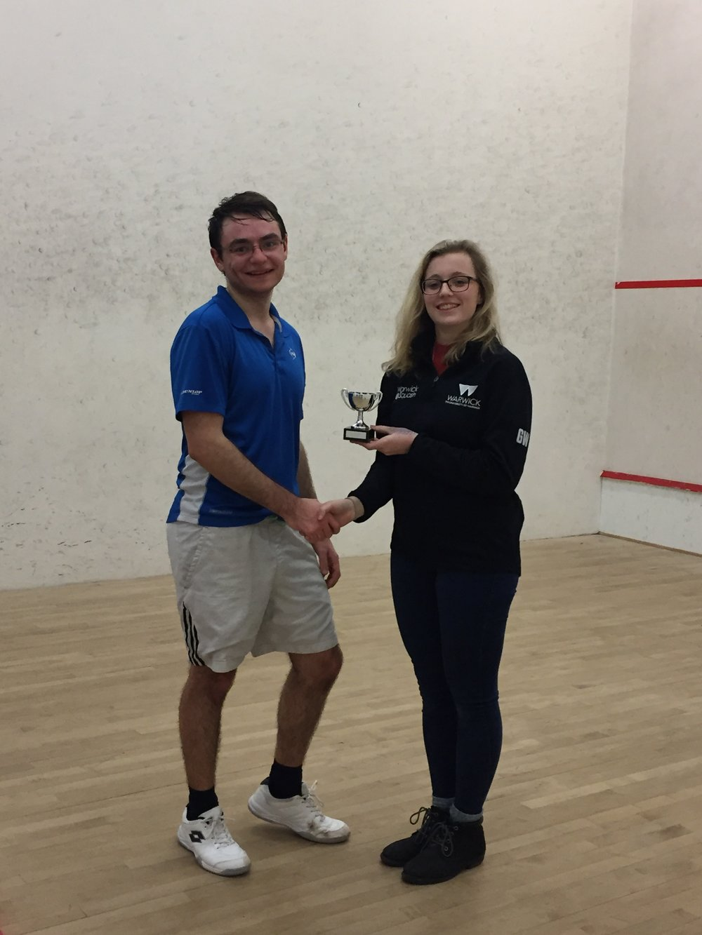 Winner of the A Grade, Nick Green (Left) receiving his trophy
