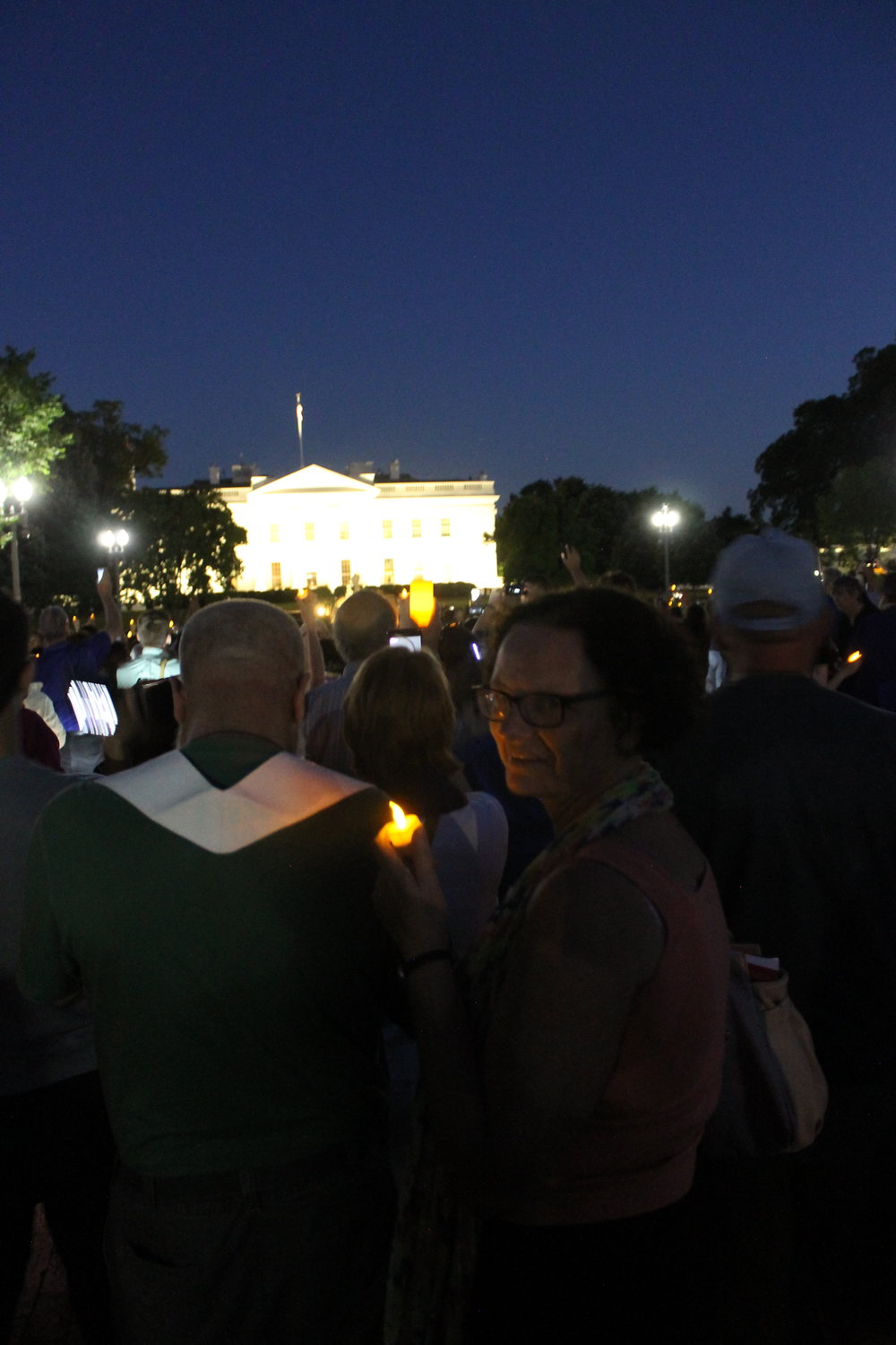 Nikki at WHite house with candle.JPG