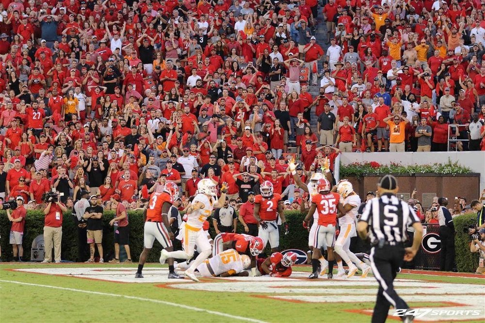 If you look closely, you will see my son and me cheering the winning touchdown