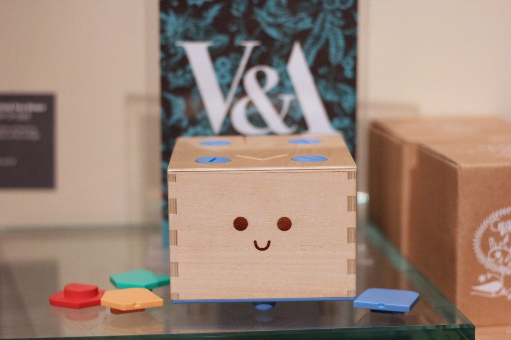 The Cubetto is a small wooden robot that kids navigate with coding blocks. Photo courtesy of Primo Toys.