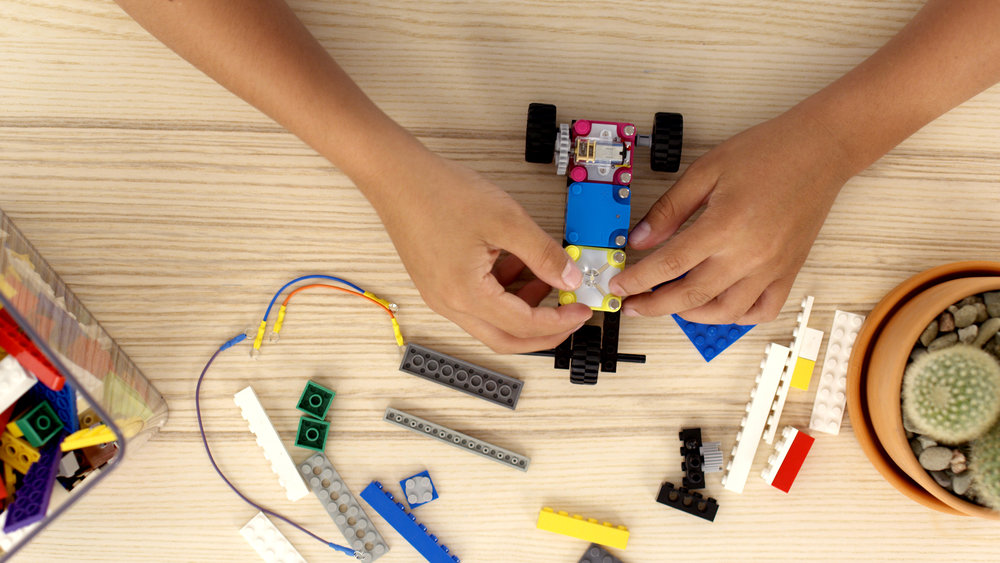 The Circuit Cubes Kits contain electronic building blocks that kids can use to build their own toys and understand the mechanics behind it. Photo courtesy of Tenka Labs.