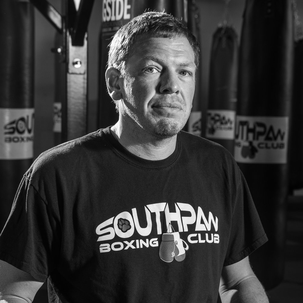 Eric Asher - Owner & Head Coach of Southpaw Boxing Club.Eric has a love for boxing! He's been watching it since he was a kid, and started boxing in 1990. He had his first AMATEUR fight in 1991, then in 2003 Eric turned pro. Eric has been training people in boxing for the last 10 years.