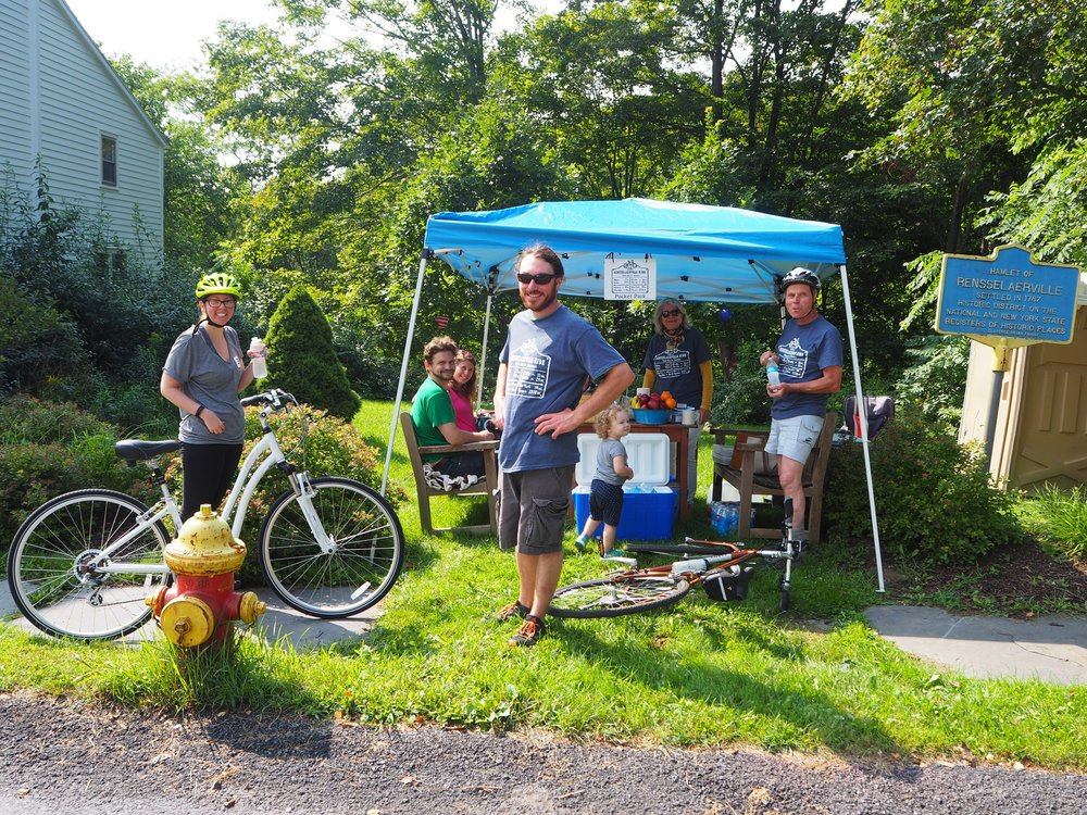 Renselaerville Aid Station, busy with riders, smiling volunteers and lots of tasty snacks