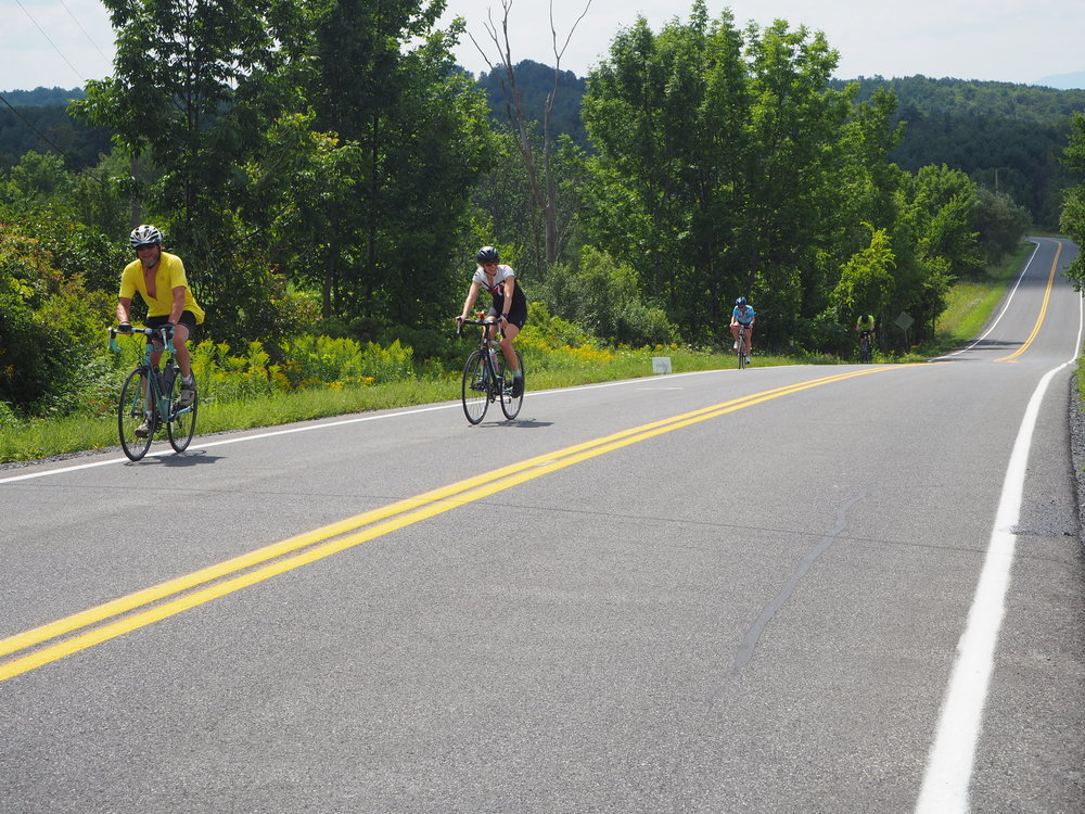 Riders enjoying a quiet stretch of County Route 408 just before their second aid station stop of the day