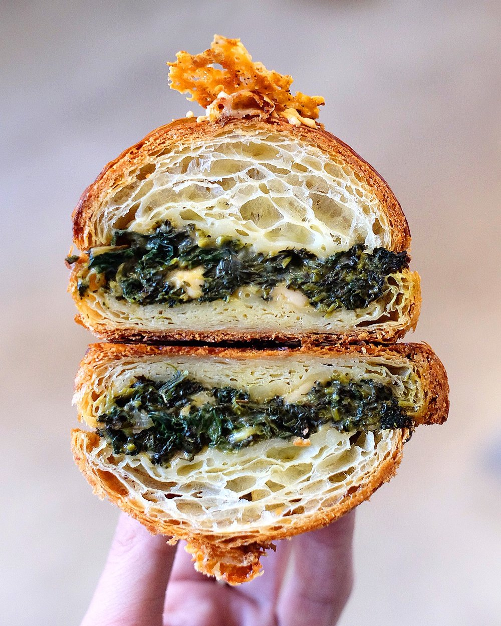 SPINACH PIE TWICE BAKED CROISSANT $8 - spinach, OLIVE OIL BAKED broccoli rabe, SAUTEED onion, chilli, béchamel, cheddar cheese.