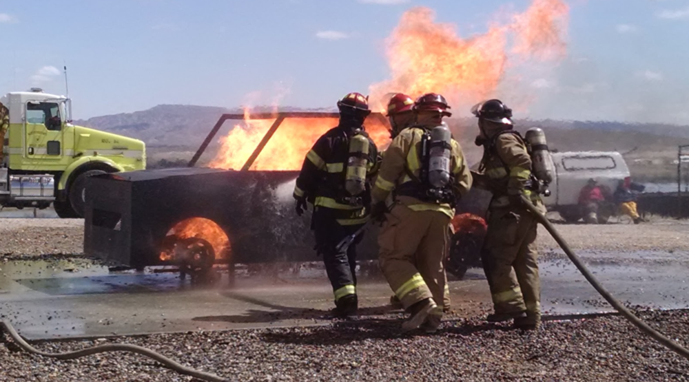 Fort Ellis volunteers participate in a car fire training drill at the annual Cody Fire School.