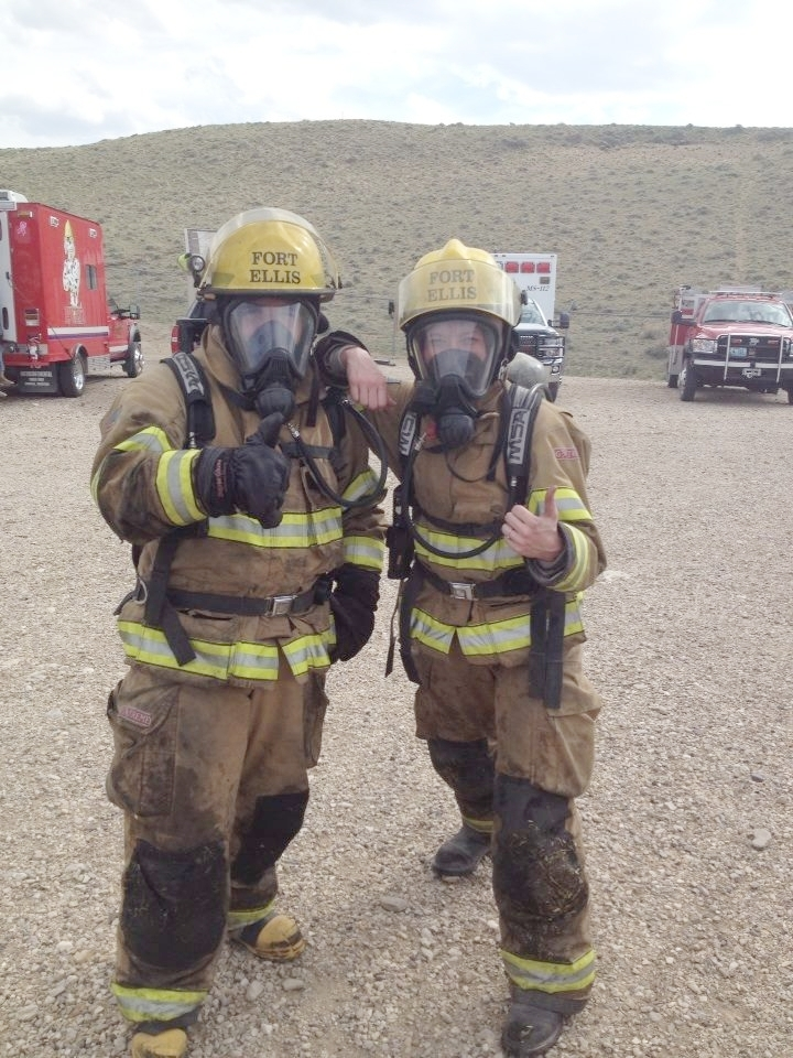 "Firefighters exit the ""burn house"" at Cody Fire School - a fire training academy in Wyoming that prepares firefighters for the hazardous conditions of structure firefighting."