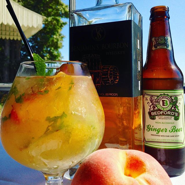 Drink a peach. Peach Bourbon Smash. Roasted Eastern Washington peach purée, Valley Shine 'Benjamin's Bourbon', muddled mint, Bedford's Ginger Beer.  #craftcocktails #bartender #freshfruitcocktail #pencepeaches @valleyshinedistillery #bedfordssoda