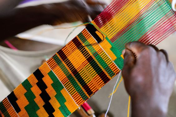 Weaver making gorgeous Kente Cloth in Africa