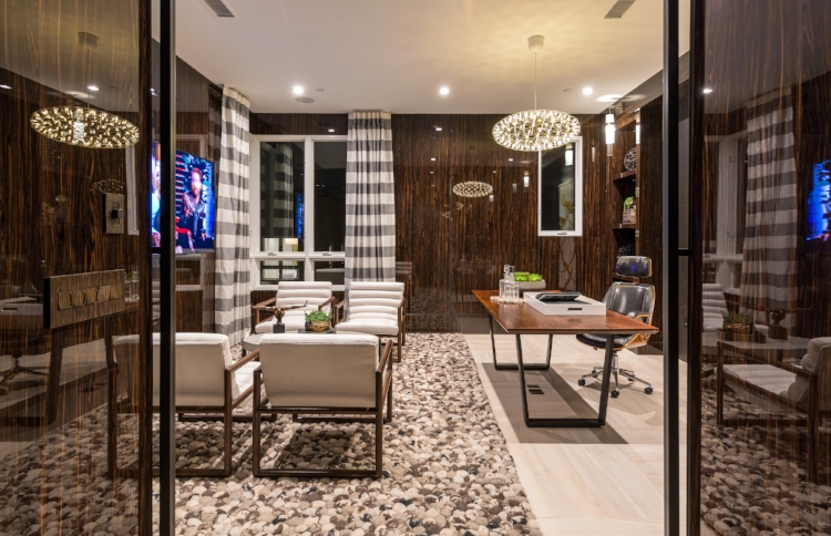 Jewel by  Brookfield Residential  features full height Zebrawood walls in high gloss, a conversation area and desk.