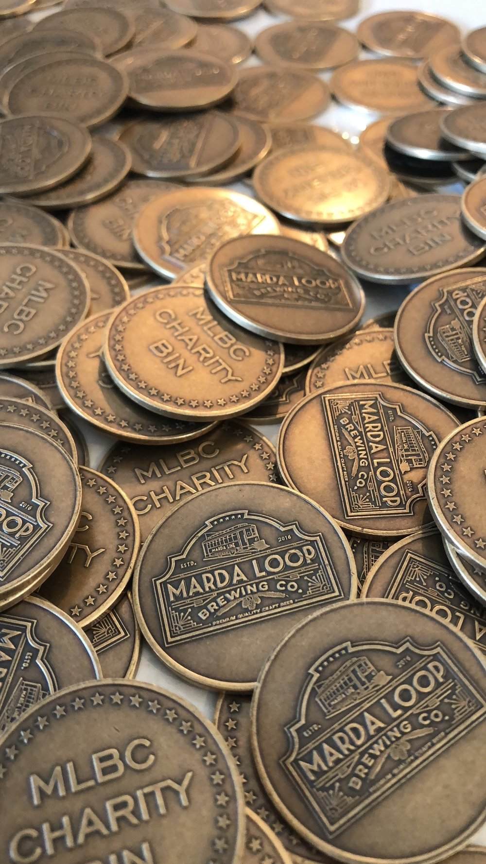 We believe in giving back. - Marda Loop Brewing believes in putting people and community first. For them, it's a no brainer. They believe in sharing the fruits of their labour with those less fortunate through their signature charity bin program.  Patrons designate the charity of their choice through Marda Loop Brewing's fun and unique coin collection system.Following your beer purchase, you will recieve a coin. Simply walk over to the charity bins and donate to the cause of your choice. Know of a charity or person in need?Fill out the form below to nominate them!Come on in and talk to one of our staff members to find out more and how you can get involved. #mlbccharitybins