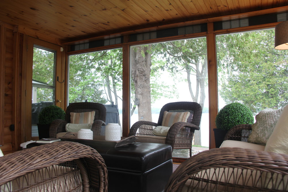 This lake-side sunroom is a wonderful way to cozy up!