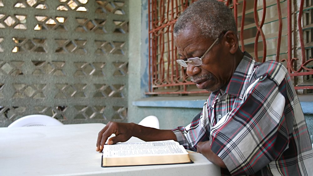 An-African-elderly-gentleman-reading-a-Bible-182389796_3456x2304.jpeg