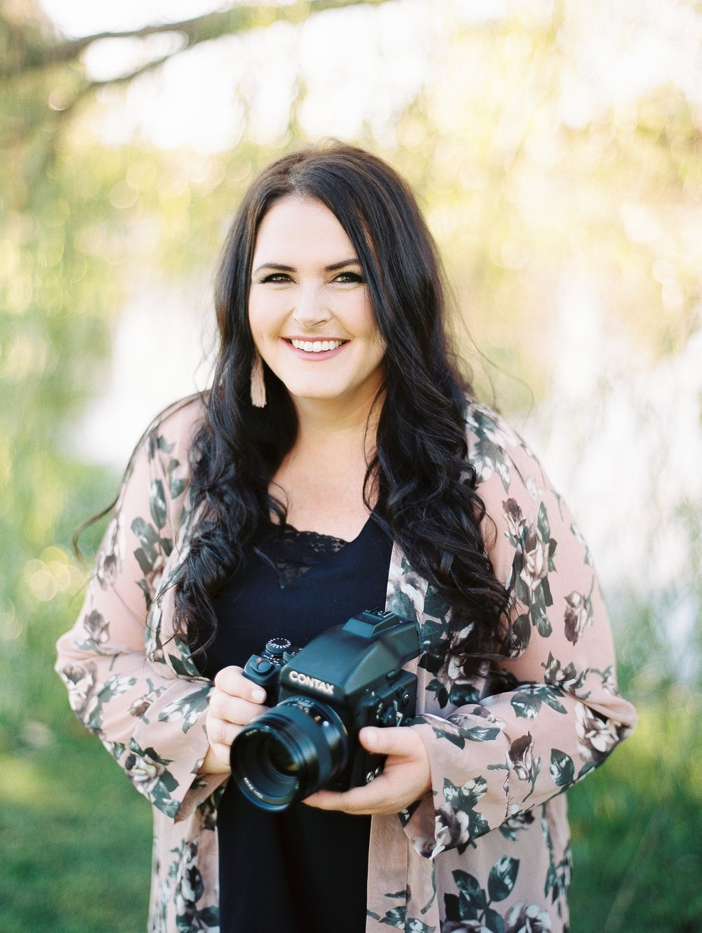Hi, I'm Erin! - Travel Enthusiast – Home Decor and Design Obsessed - WanderlustHi! I'm Erin, from Erin Wilson Photography which is a photography and cinematography business I started in 2014. Most of the time you can find me traveling, exploring, photographing and editing gorgeous photos, painting, throwing parties and making excellent charcuterie boards and maybe watching a little HGTV to get inspired during our renovation of our 1970's fixer-upper.  I'm most known for dreamy romantic  wedding photography. I love serving others by encouraging their creative sides, reminding them how beautiful they are and being as positive and calm in wild situations. I am extremely passionate about people, art and love. I photograph weddings on film and digital and very inspired by timeliness images that have a little artful vibe. Last year my husband Josh joined me in my business and we work together documenting our couples weddings in a romantic, dreamy and meaningful way. We love working as a team and work seamlessly together and I could not ask for a better partner.My husband Josh and I have two sweet children Penelope Lane (she has fire red hair and loves to sing and dance) and Emerson Gray (he has blonde hair, twinkly eyes and loves coloring and building anything with legos). We constantly try to do creative and adventurous things as a family. Sometimes we even put a tarp down in our living room and do full on painting nights as a family.