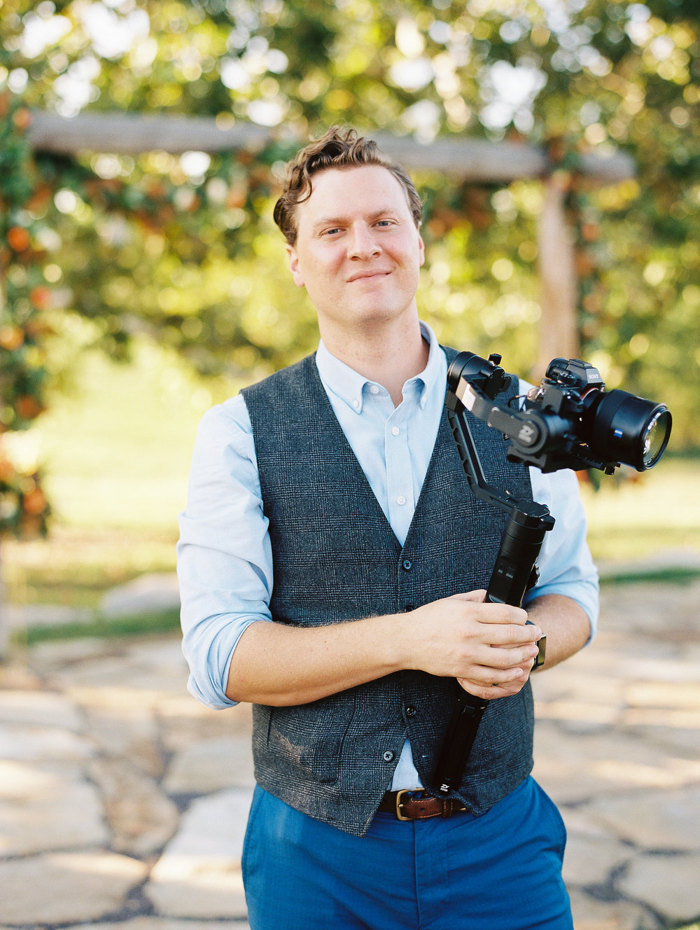 THIS IS JOSH - my husband and videographer - Josh, my husband of almost 13 years, has recently joined me in action and offers beautiful wedding videos he films right along side me. It's the best! I love that we know how to work around each other so well on a wedding day and that our work style flows together seamlessly. He loves story telling and creating beautiful wedding films for our couples.Josh loves music, a great movie, dance parties with our two little ones, podcasts, audiobooks, basketball (he's a little obsessed with Lebron James), live bands, good shoes and takes longer than me to fix his hair. ;) We love family movie nights and going on adventures together. We have been working for a few years fixing up our house and Josh takes care of all the handyman projects including recently gutting and remodeling one of our 70's bathrooms. We've been loving working as a team serving our couples and documenting one of the most important days of their lives!Our goal is to serve our couples as a team and work fluidly together on your wedding day. I love the fact that we know each other so well and know the ins and outs of a wedding day to move around each other as a team documenting each and everyone our couples days in a beautiful way. Josh works to tell your story in a thoughtful, meaningful and beautiful way. A writer at heart he loves the story behind everything and every detail.