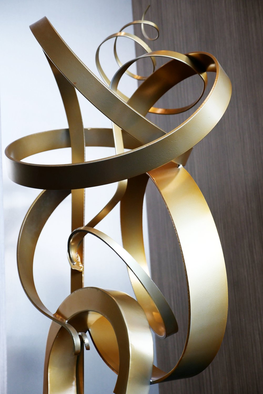 Abstract sculptures by Kalisher in the prefunction area mimic the fluid movement of the sport.