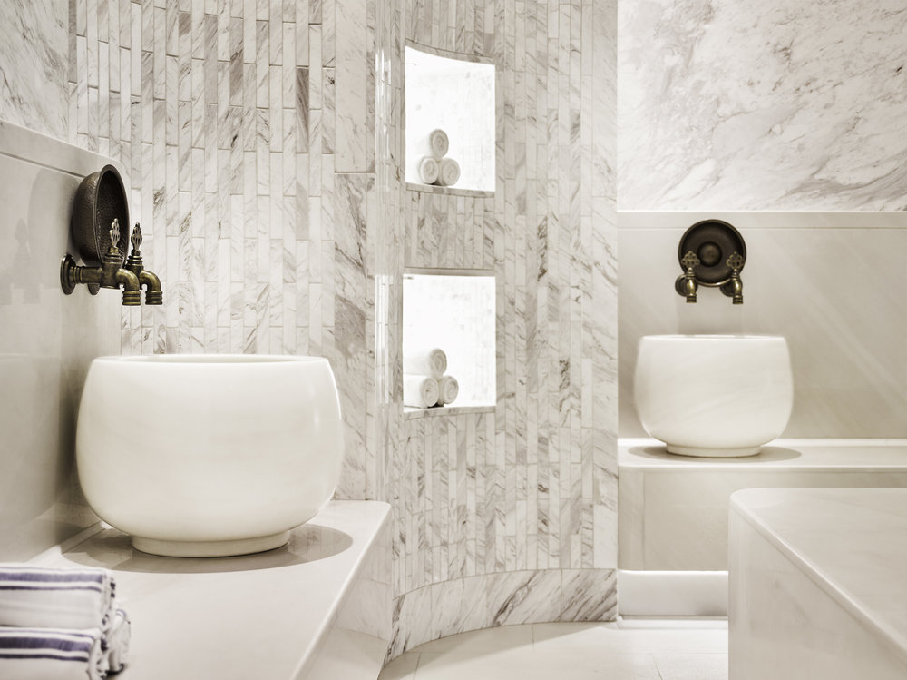 "This traditional Turkish ""Hamam"" spa features white-on-white, marble-clad walls and benches, finished with traditionally inspired Turkish faucets and hardware."