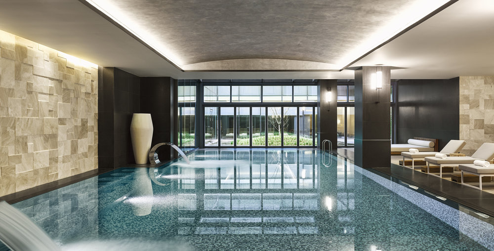 The indoor pool area boasts tumbled limestone, honed black granite and teakwood and is lined with mixed silver mosaics, highlighted with custom sconces draped from each column.