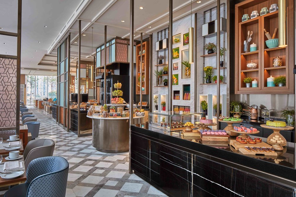 The dessert counter is reminiscent of a walk-in chocolate jewelry box.